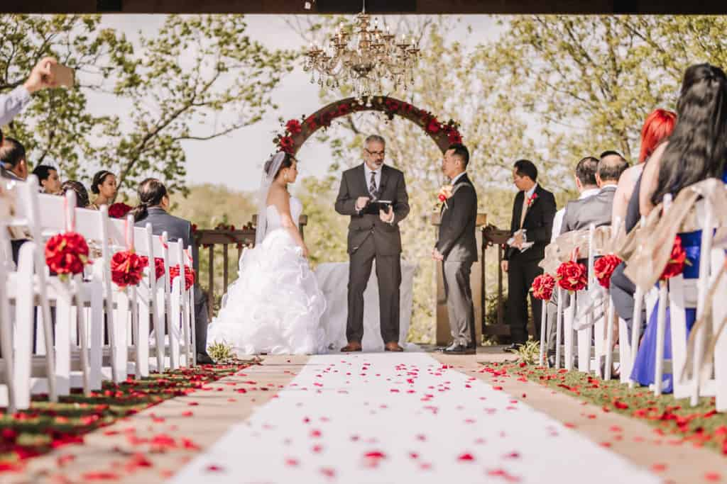 davids bridal, bridesmaids, the springs event center tulsa, veil, bride, updo, gold sequins, red roses, oklahoma brides, von maur