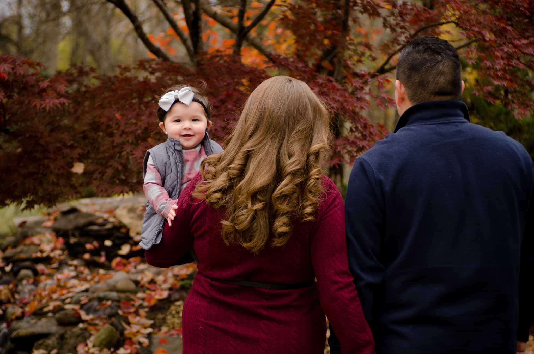 Autumn foliage, fall colors, toddler, white bow