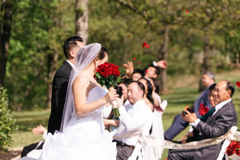 Wedding day, red bouquet, red roses, bridal veil, white wedding