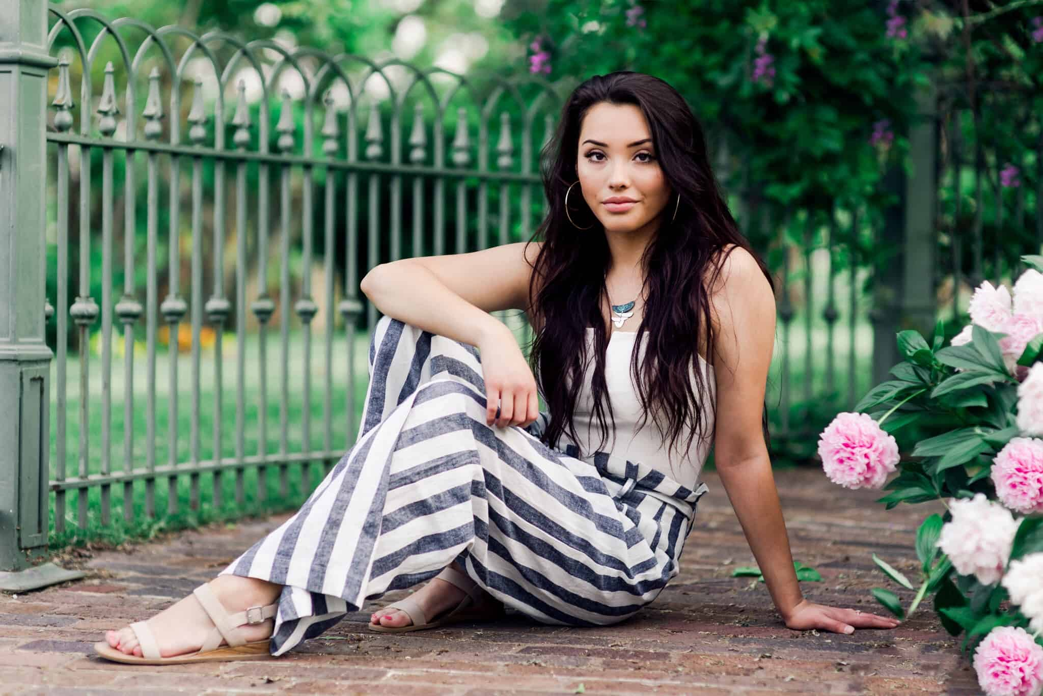 Senior portraits, Gilcrease museum, pink flowers, white flowers, romper