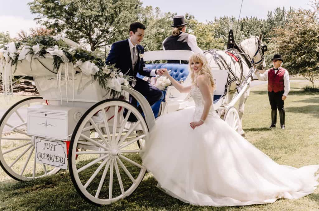 Horse and carriage, bride and groom, wedding photographers tulsa, grand exit, white dress, she said yes, wedding dress, fairytale wedding, blue tux, coachman